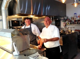 Steve (left) and his right hand man in the kitchen