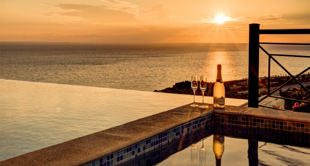 Sunset views over the sea from the pool's edge at Villa TV04, Aphrodite Hills Resort, Cyprus