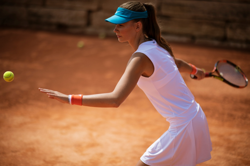 Female playing tennis - Aphrodite Hills Tennis Academy, Cprus